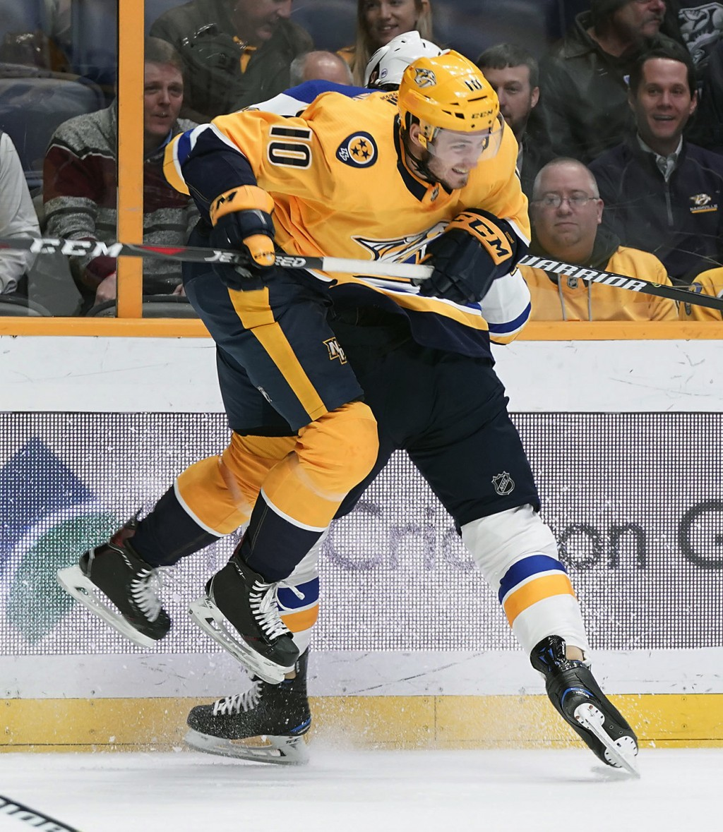 Nashville Predators Colton Sissons (10) alludes a hit by St. Louis Blues Chris Thorburn (22) in the first period of an NHL hockey game Tuesday, Feb. 1