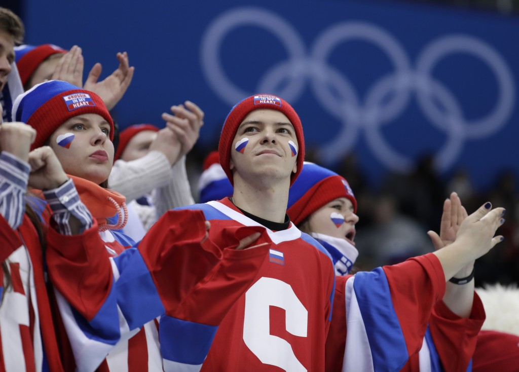 Russian supporters wait before the preliminary round of the men's hockey game between Slovakia and the team from Russia at the 2018 Winter Olympics in