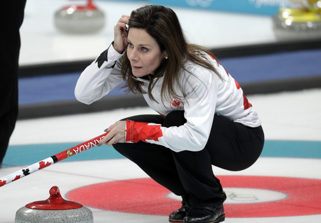 Canadian curler Cheryl Bernard arranges her hair during training sessions for the women's curling matches at the 2018 Winter Olympics in Gangneung, So