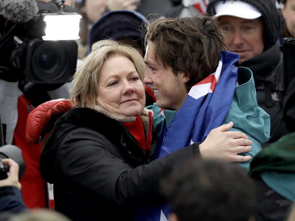 Bronze medal winner Scotty James, of Australia, hugs his mom, Celia, after the men's halfpipe finals at Phoenix Snow Park at the 2018 Winter Olympics