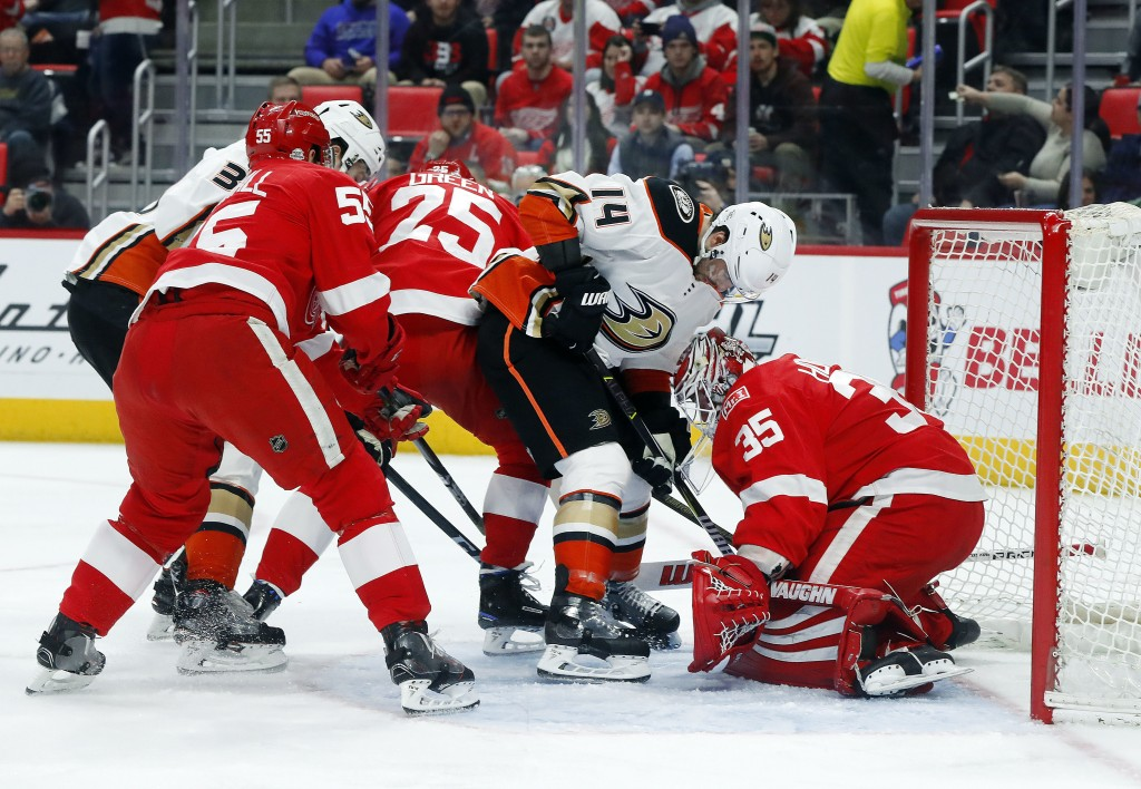 Detroit Red Wings goaltender Jimmy Howard (35) stops a Anaheim Ducks center Adam Henrique (14) shot in the first period of an NHL hockey game Tuesday,
