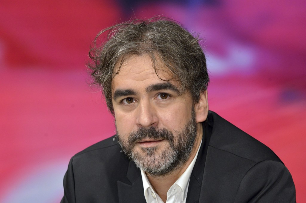 FILE - In this July 21, 2016 file photo German-Turkish journalist Deniz Yucel is pictured during a talkshow in Berlin, Germany. Yucel was imprisoned i