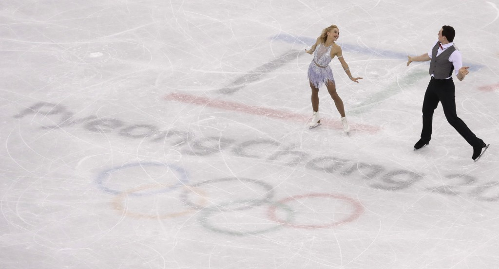 Aljona Savchenko and Bruno Massot of Germany perform in the pair figure skating short program in the Gangneung Ice Arena at the 2018 Winter Olympics i