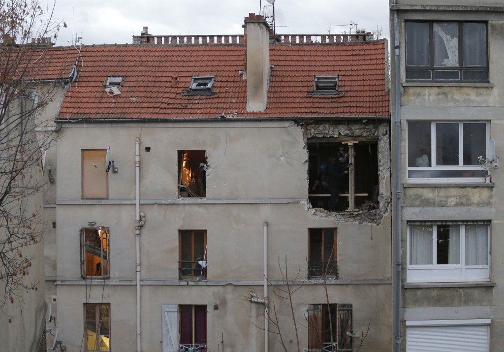FILE - In this Nov.19, 2015 file photo, the building of the police raid on an apartment is pictured in Paris suburb Saint-Denis. A French court is exp...
