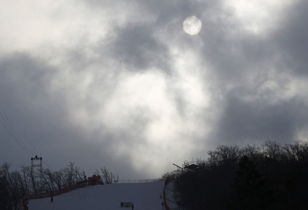 The sun shines through clouds at the women's slalom at Yongpyong alpine center at the 2018 Winter Olympics in Pyeongchang, South Korea, Wednesday, Feb