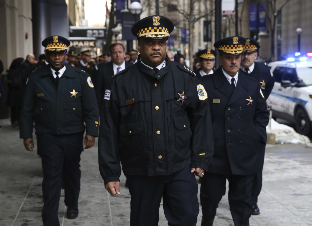 Chicago police officers arrive for a news conference at Northwestern Memorial Hospital, regarding Cmdr. Paul Bauer, who was killed earlier in Chicago