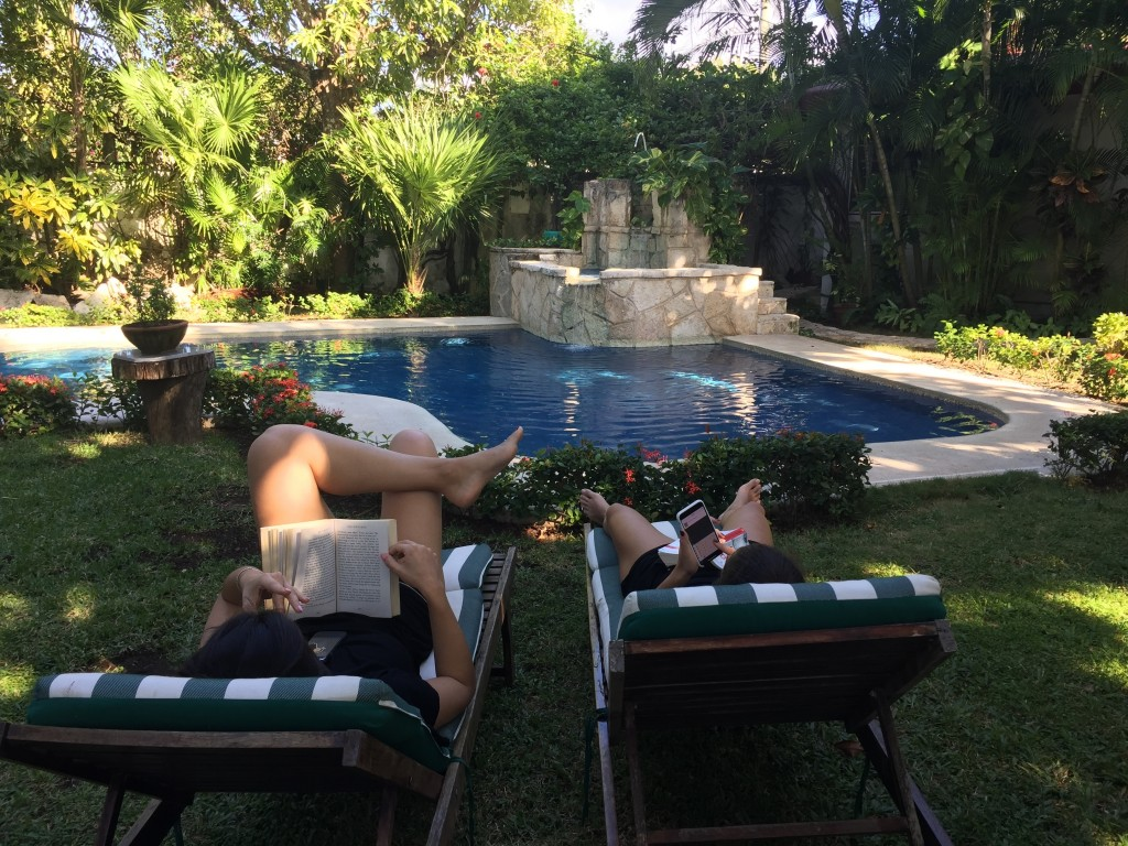 This Dec. 24, 2017 photo taken in Cozumel, Mexico shows people relaxing by the pool in the yard of their Airbnb rental. Mexico is a popular vacation d