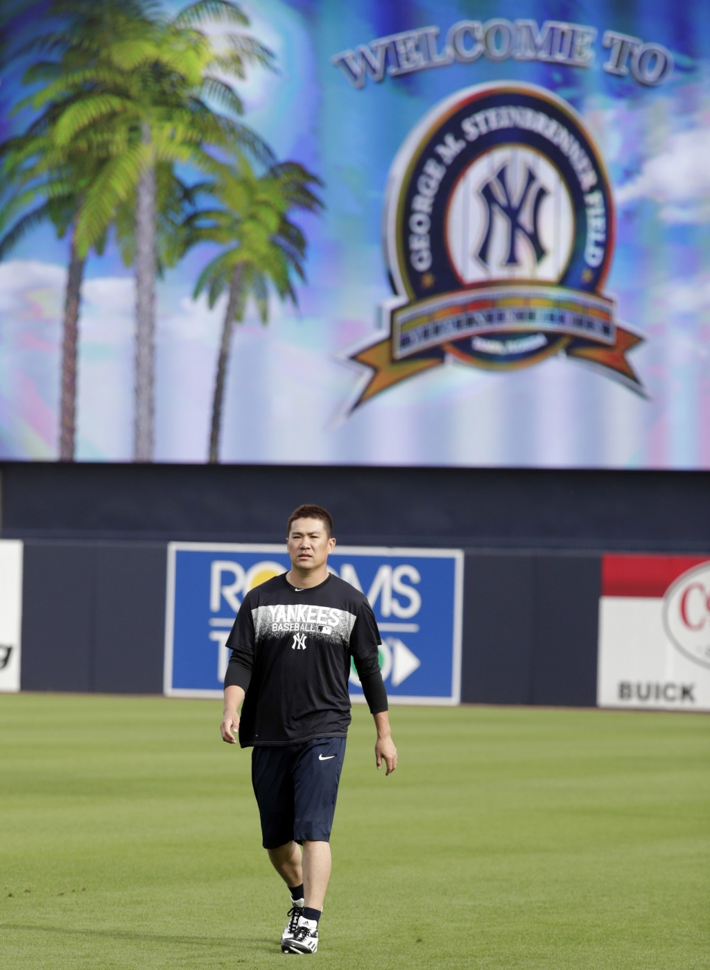 New York Yankees starting pitcher Masahiro Tanaka, of Japan, works out on the field during baseball spring training, Tuesday, Feb. 13, 2018, in Tampa,