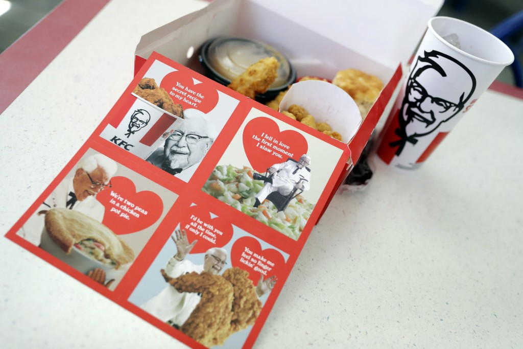 Valentine's Day scratch-and-sniff cards, which give off a fried chicken aroma, sit on a table at a KFC, Tuesday, Feb. 13, 2018, in Santa Clara, Calif.