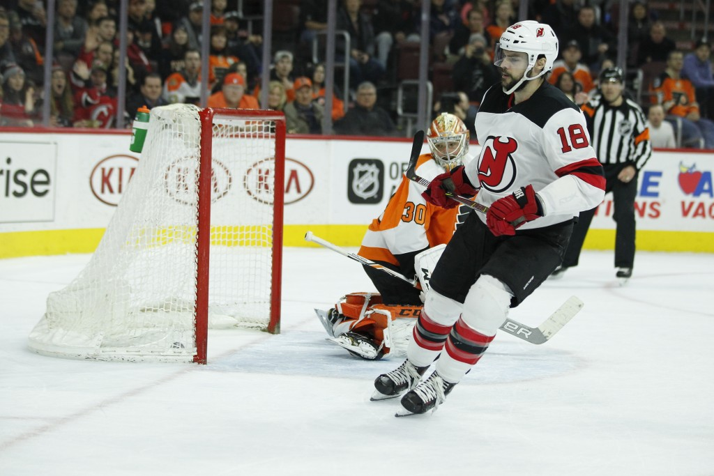 Philadelphia Flyers' Michal Neuvirth looks over his shoulder at the puck in the net after New Jersey Devils' Drew Stafford scored to win the shootout