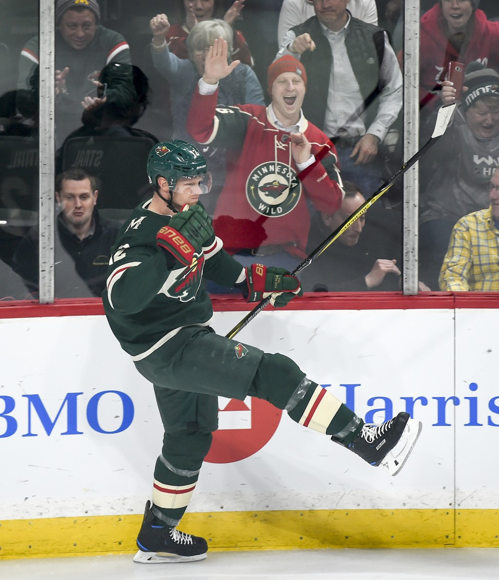 Minnesota Wild center Eric Staal celebrates after scoring against the New York Rangers during the first period of an NHL hockey game Tuesday, Feb. 13,