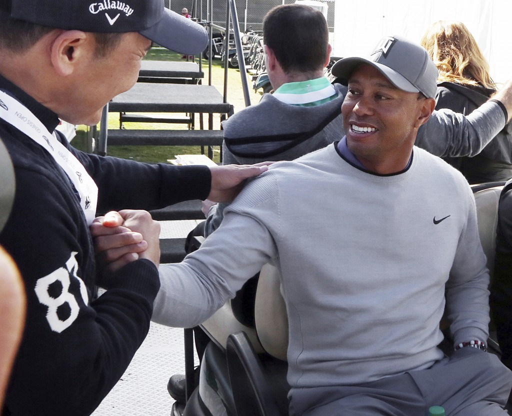 Tiger Woods greets a wellwisher after a news conference where he talked about his charitable works off the course and his return to competitive golf i