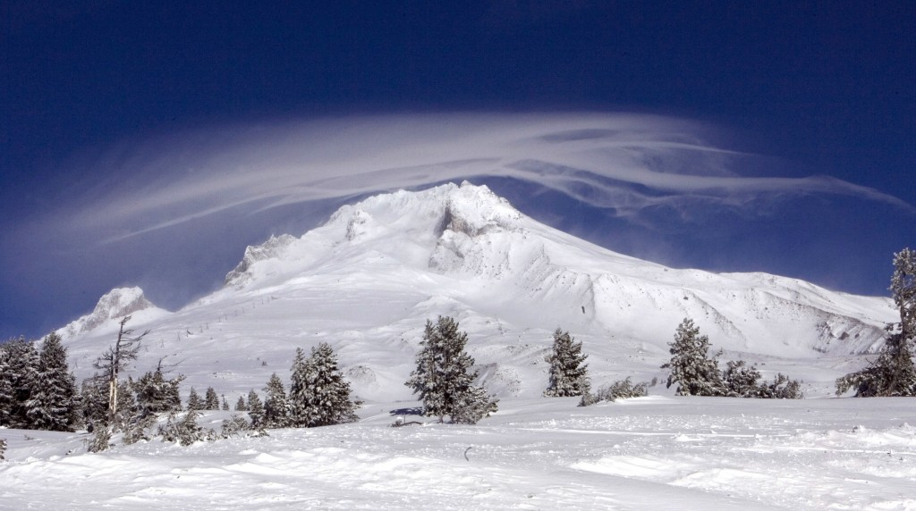 FILE - In this Dec. 13, 2009, file photo, a cloud forms over Mount Hood as seen from Government Camp, Ore. Authorities say a rescue effort is underway