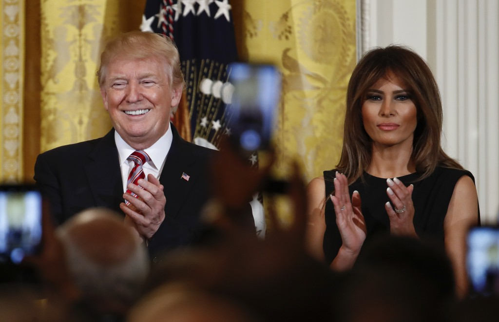 President Donald Trump and first lady Melania Trump applaud during the National African American History Month reception in the East Room of the White