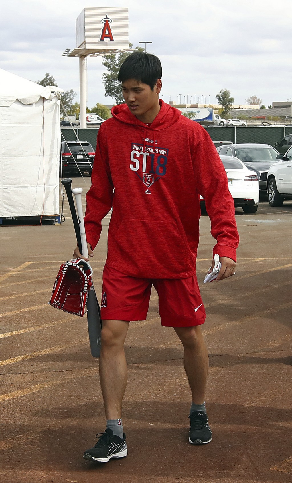 Los Angeles Angels' Shohei Ohtani walks from the batting cage during a spring training baseball practice on Tuesday, Feb. 13, 2018, in Tempe, Ariz. (A