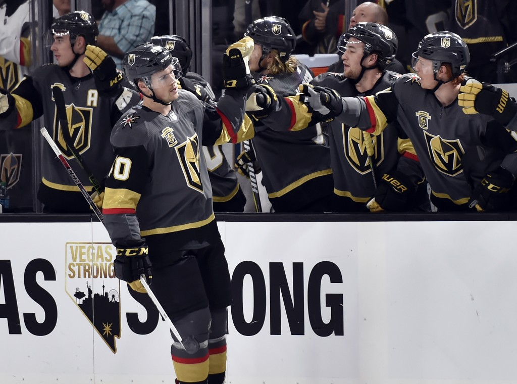 Vegas Golden Knights center Ryan Carpenter (40) celebrates with his team after scoring against the Chicago Blackhawks during the first period of an NH