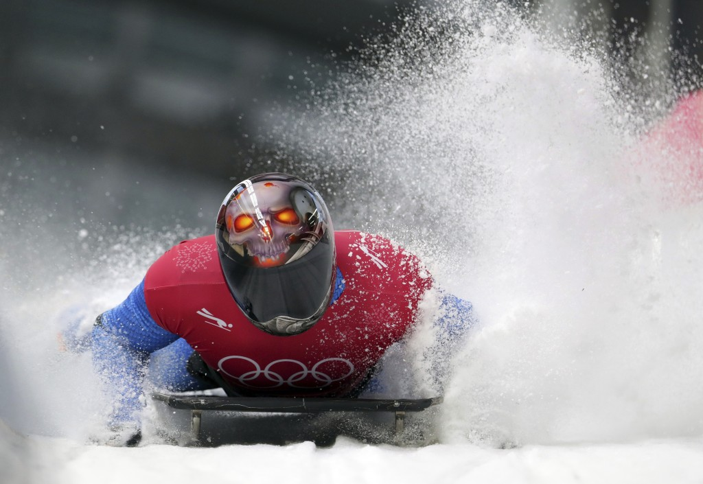 Joseph Luke Cecchini of Italy brakes in the finish area during the men's skeleton training at the 2018 Winter Olympics in Pyeongchang, South Korea, We
