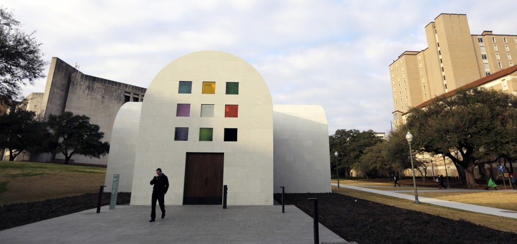 """In this Monday, Feb. 12, 2018, photo, a man passes Ellsworth Kelly's """"Austin"""" at the Blanton Museum of Art, in Austin, Texas. The exhibit, a 2,715-squ"""