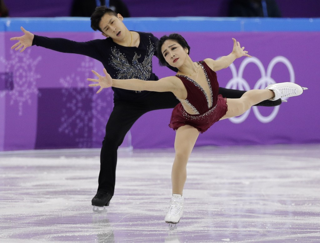 Sui Wenjing and Han Cong of China perform in the pair figure skating short program in the Gangneung Ice Arena at the 2018 Winter Olympics in Gangneung