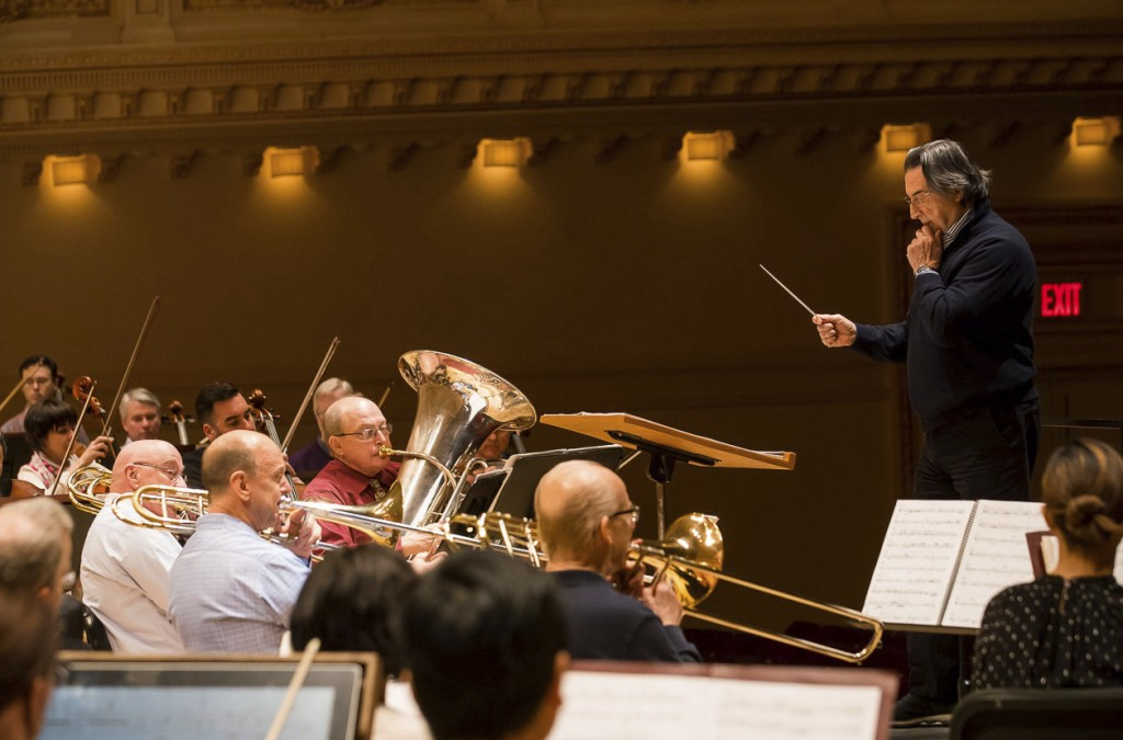 This Feb. 9, 2018 photo released by the Chicago Symphony Orchestra shows Riccardo Muti, standing right, during a rehearsal for the Chicago Symphony Or