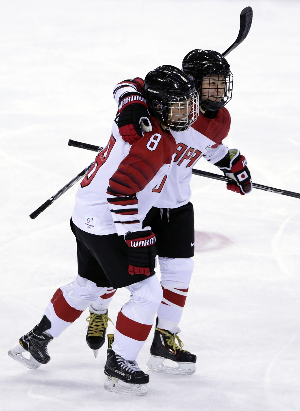 Shiori Koike celebrates with Akane Hosoyamada (8), of Japan, after scoring a goal against the combined Koreas during the third period of the prelimina