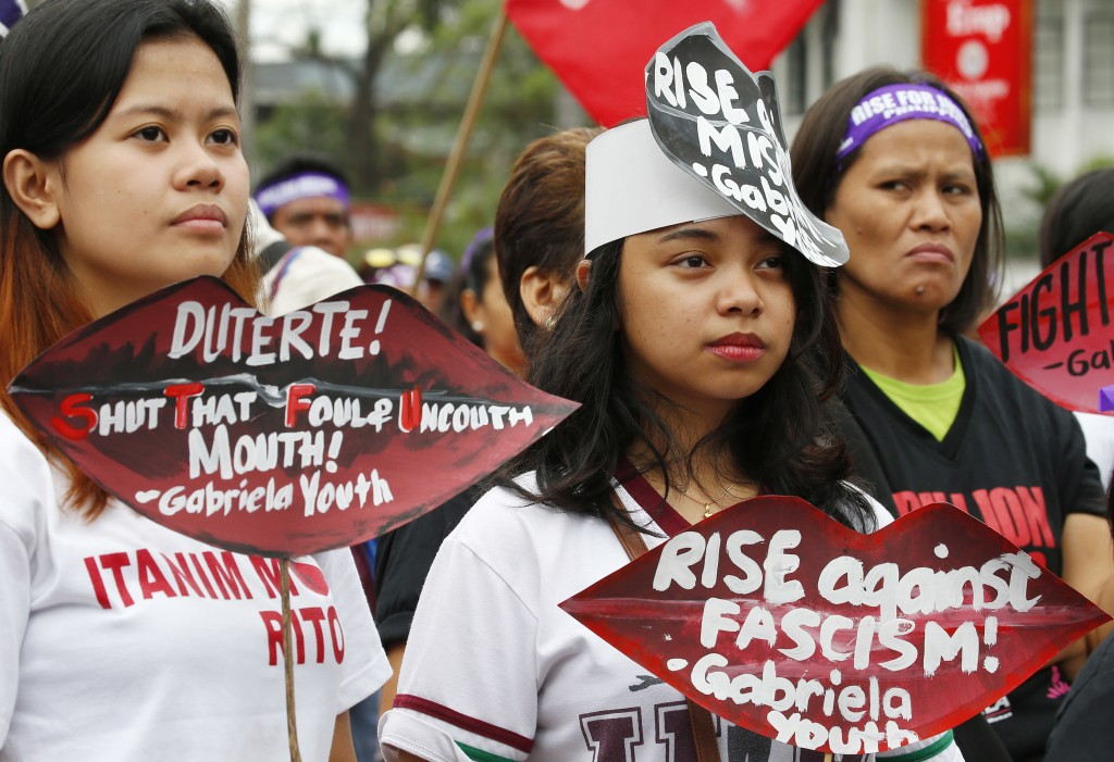 Protesters display lip-shaped cutouts with their message during a Valentine's Day rally to denounce President Rodrigo Duterte's use of vulgarities  as...