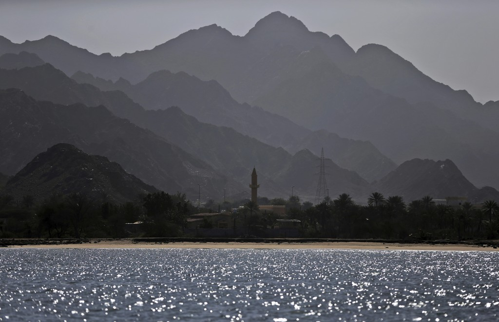 In this Jan. 23, 2018 photo, a mosque's minaret and the Shumayliyah Mountains are seen from Dibba Bay on the Arabian Sea, in Dibba, United Arab Emirat