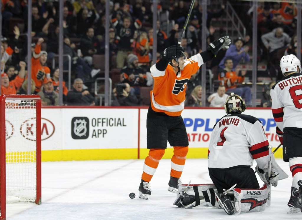 Philadelphia Flyers' Jori Lehtera, left, celebrates the goal by Claude Giroux scored on New Jersey Devils goalie Keith Kinkaid during the second perio
