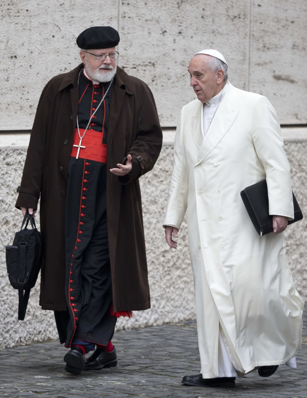 FILE - In this Feb. 13, 2015 file photo, Pope Francis talks with his top abuse adviser Cardinal Sean Patrick O'Malley, left, as they arrive for a spec