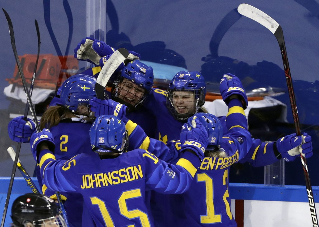 Anna Borgqvist (18), of Sweden, celebrates with her teammates after scoring a goal against Switzerland during the third period of the preliminary roun