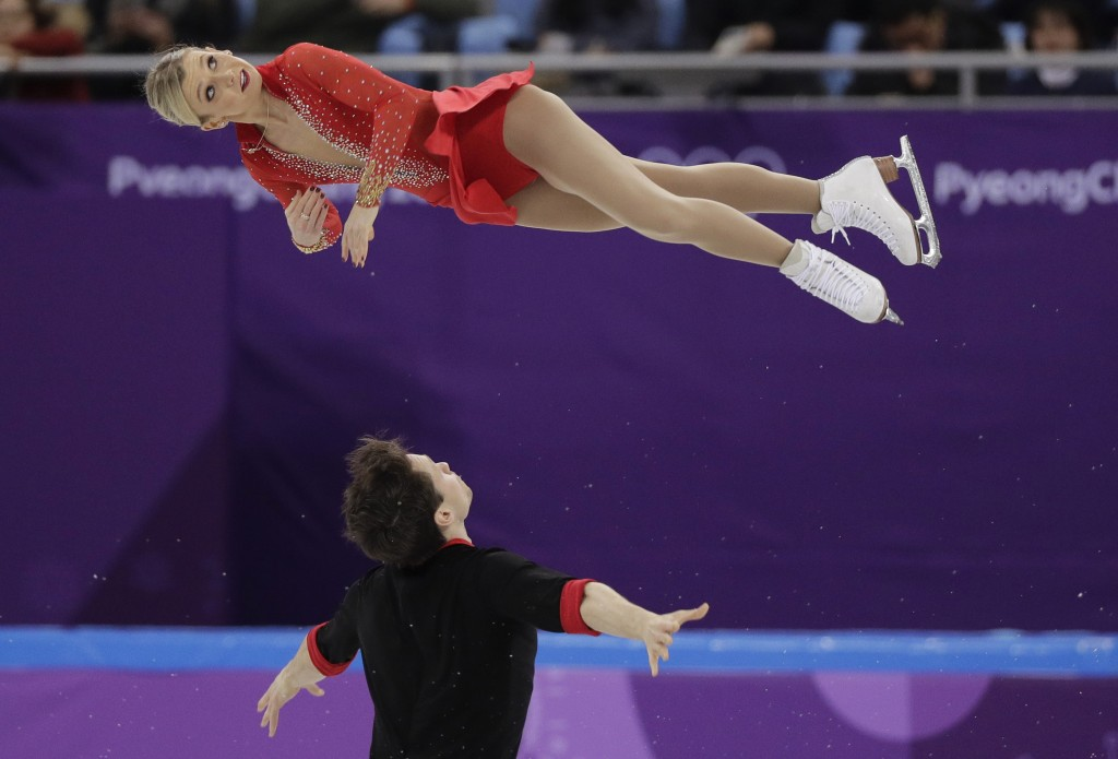 Kirsten Moore-Towers and Michael Marinaro of Canada perform in the pair figure skating short program in the Gangneung Ice Arena at the 2018 Winter Oly