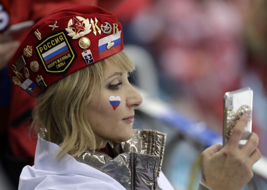 A supporter of Russian athlete wait before the preliminary round of the men's hockey game between Slovakia and the team from Russia at the 2018 Winter