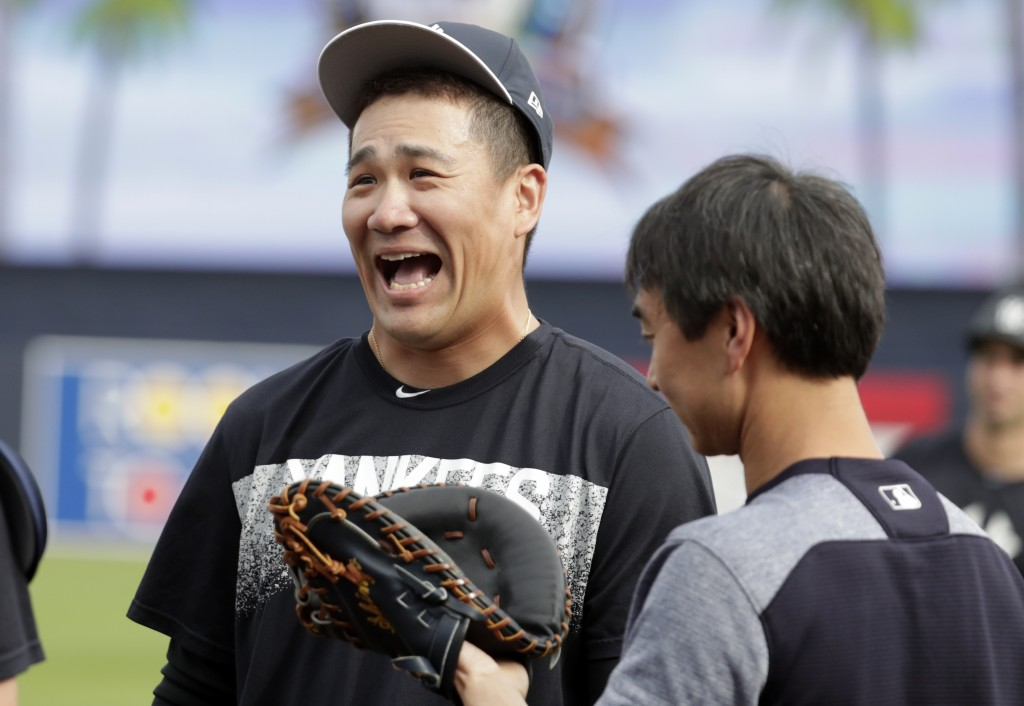 New York Yankees starting pitcher Masahiro Tanaka, of Japan, laughs as he works out during baseball spring training, Tuesday, Feb. 13, 2018, in Tampa,