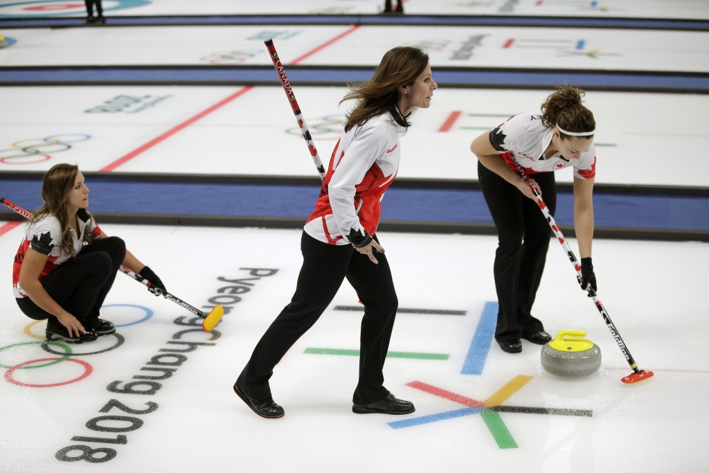 Canadian curler Cheryl Bernard, center, joins a training session for the women's curling matches at the 2018 Winter Olympics in Gangneung, South Korea