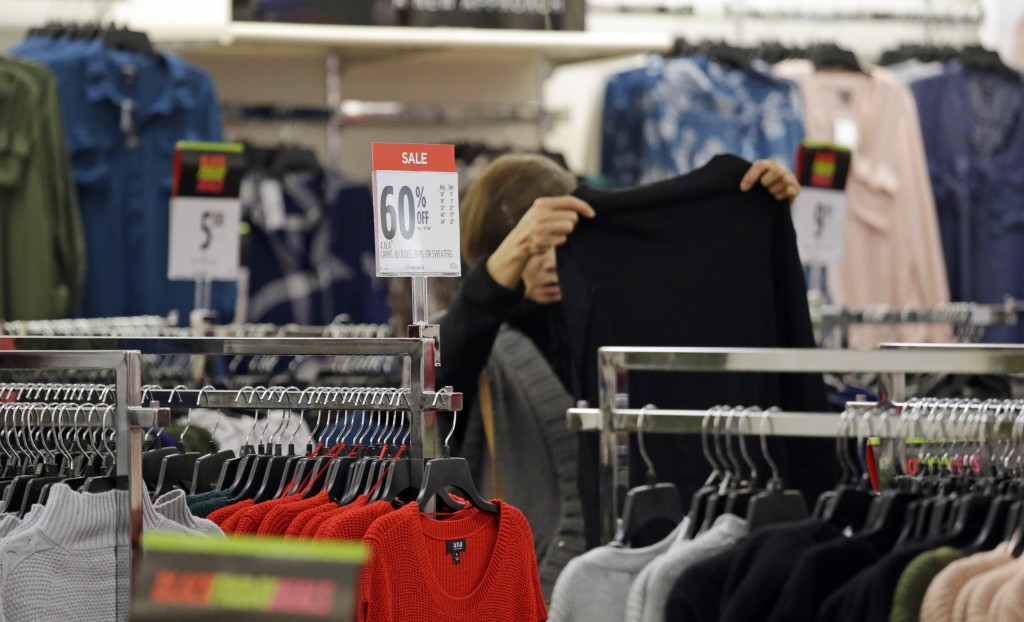 FILE- In this Nov. 24, 2017, file photo, a shopper looks over clothing at a J.C. Penney store in Seattle. On Wednesday, Feb. 14, 2018, the Labor Depar