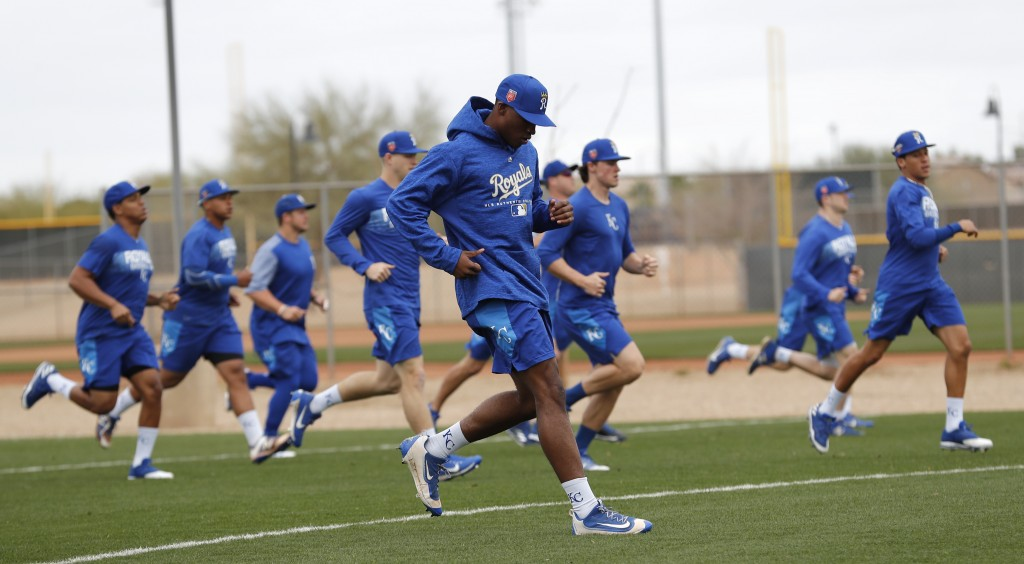 Kansas City Royals non-roster invitees run on a field during a baseball spring training workout, Tuesday, Feb. 13, 2018, in Surprise, Ariz. (AP Photo/