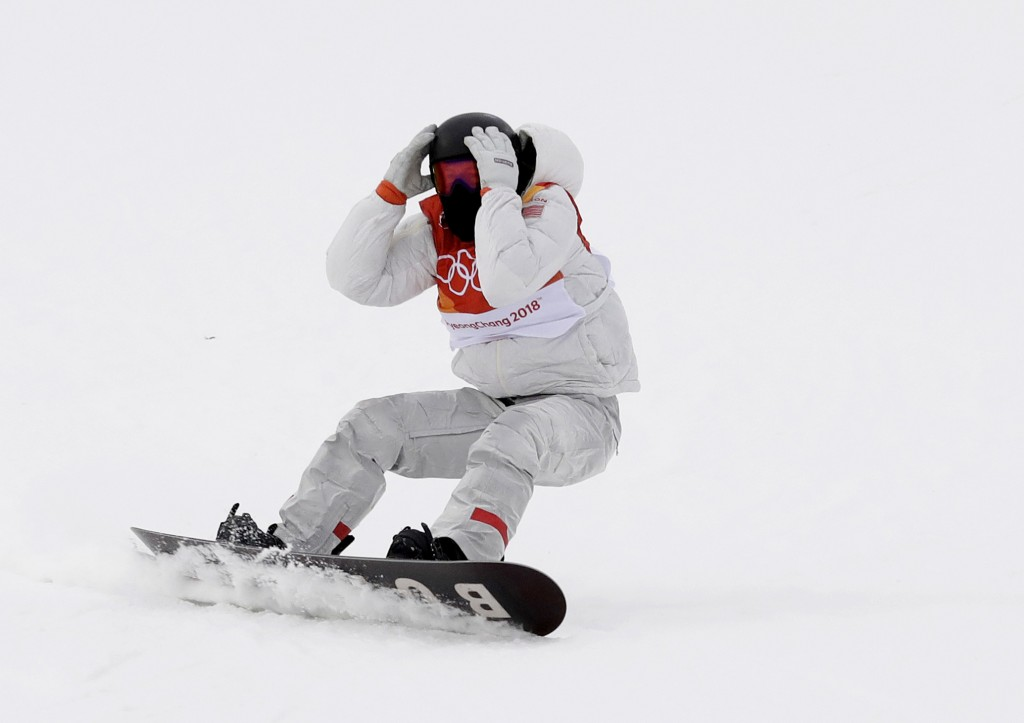 Gold medal winner Shaun White, of the United States, reacts after finishing his run during the men's halfpipe finals at Phoenix Snow Park at the 2018