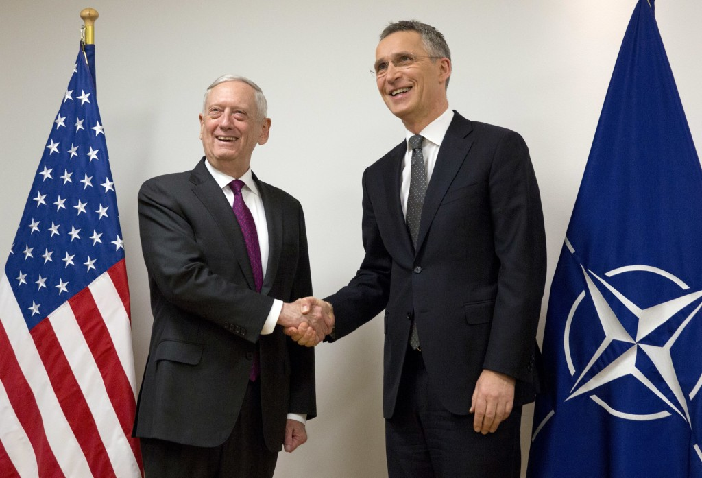 NATO Secretary General Jens Stoltenberg, right, shakes hands with U.S. Secretary for Defense Jim Mattis prior to a meeting at NATO headquarters in Bru