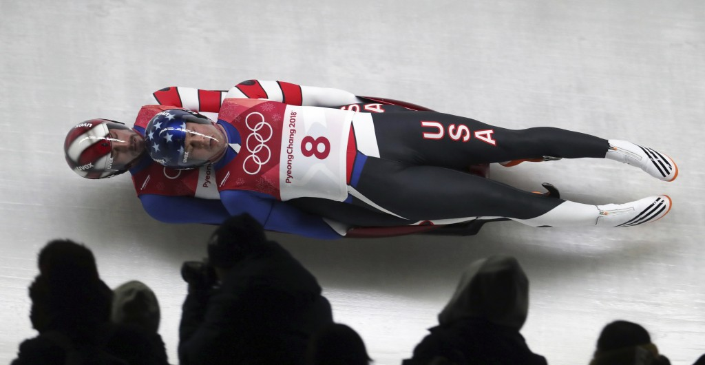 Matthew Terdiman and Jayson Mortensen of United States take a curve on their first run during the men's doubles luge final at the 2018 Winter Olympics