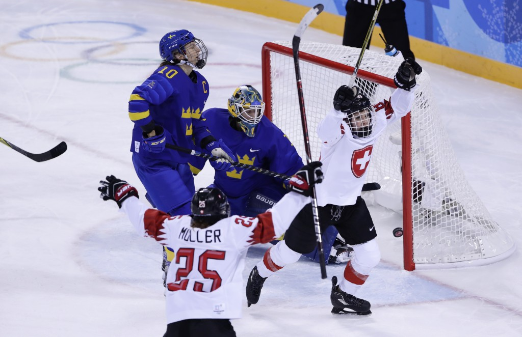 Phoebe Staenz (88), of Switzerland, reacts after scoring a goal against goalie Sara Grahn (1), of Sweden, during the third period of the preliminary r