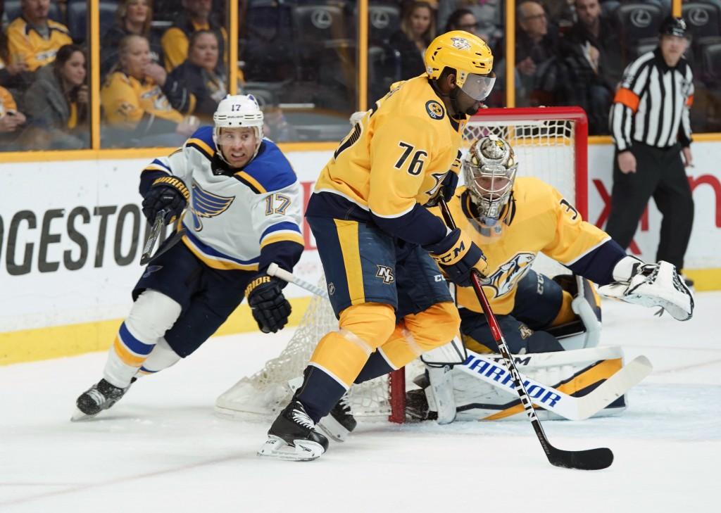 Nashville Predators defenseman P.K. Subban (76) skates the puck past Pekka Rinne (35), of Finland, as St. Louis Blues Jaden Schwartz (17) follows in t