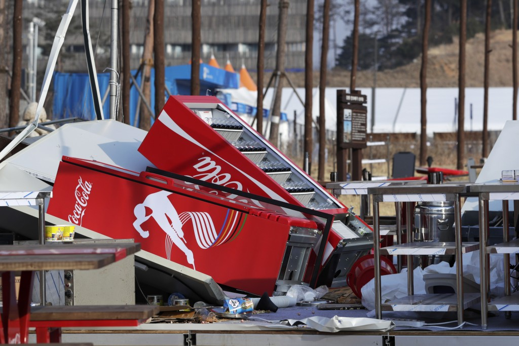 Refrigerators are toppled after they were blown over at a concession stand by gusty winds at the Olympic Park at the 2018 Winter Olympics in Gangneung