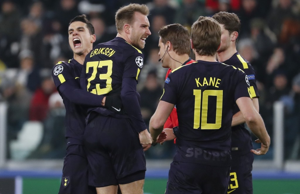 Tottenham's Christian Eriksen, 2nd left, celebrates with teammate Erik Lamela and Harry Kane, right, after scoring his side's second goal during the C