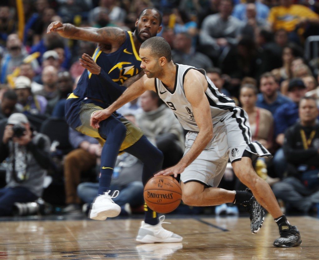 San Antonio Spurs guard Tony Parker, front, drives past Denver Nuggets guard Will Barton during the first half of an NBA basketball game Tuesday, Feb.