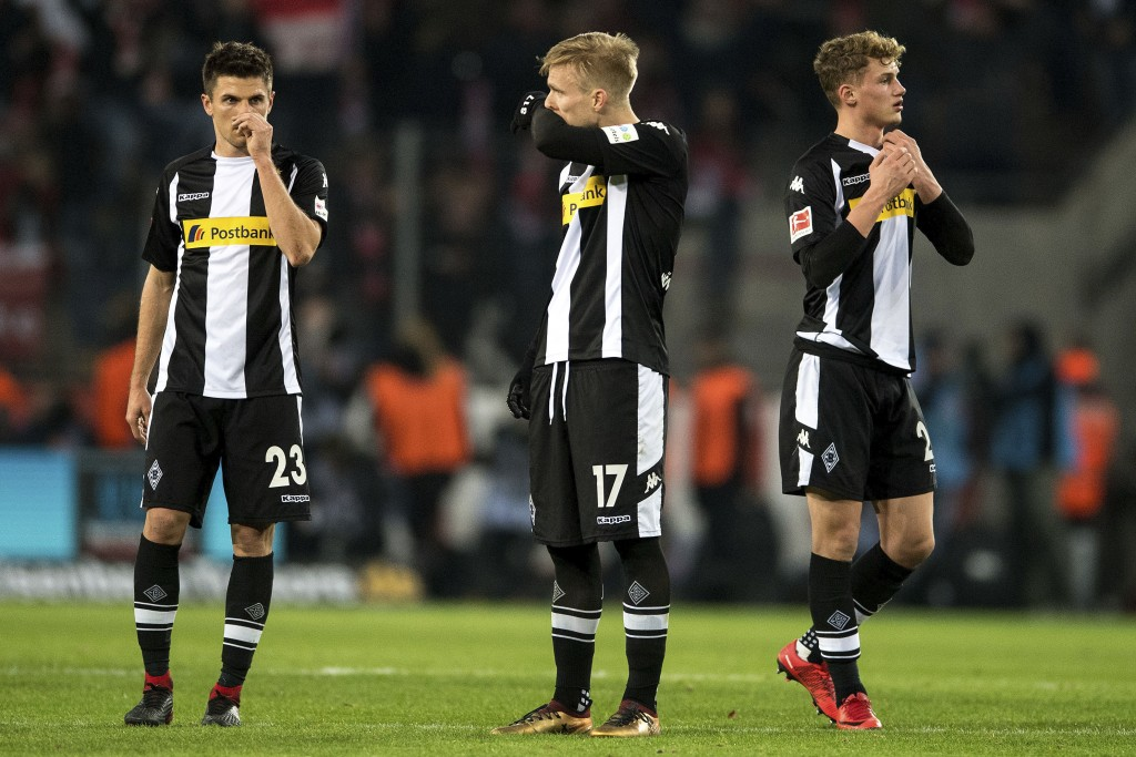FILE - In this Jan. 14, 2018 file photo Moenchengladbach's Jonas Hofmann, Oscar Wendt and Mickael Cuisance, from left, react after the German Bundesli