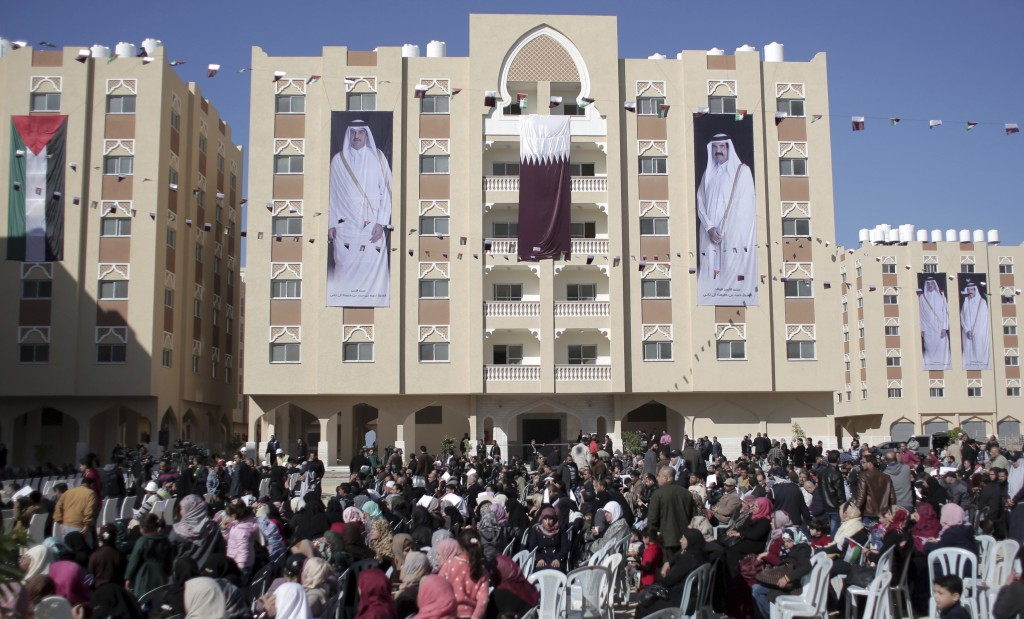 FILE - In this Jan. 16, 2016 photo, Palestinians gather at the Qatari-funded Hamad City housing complex in Khan Younis, southern Gaza Strip. Four year