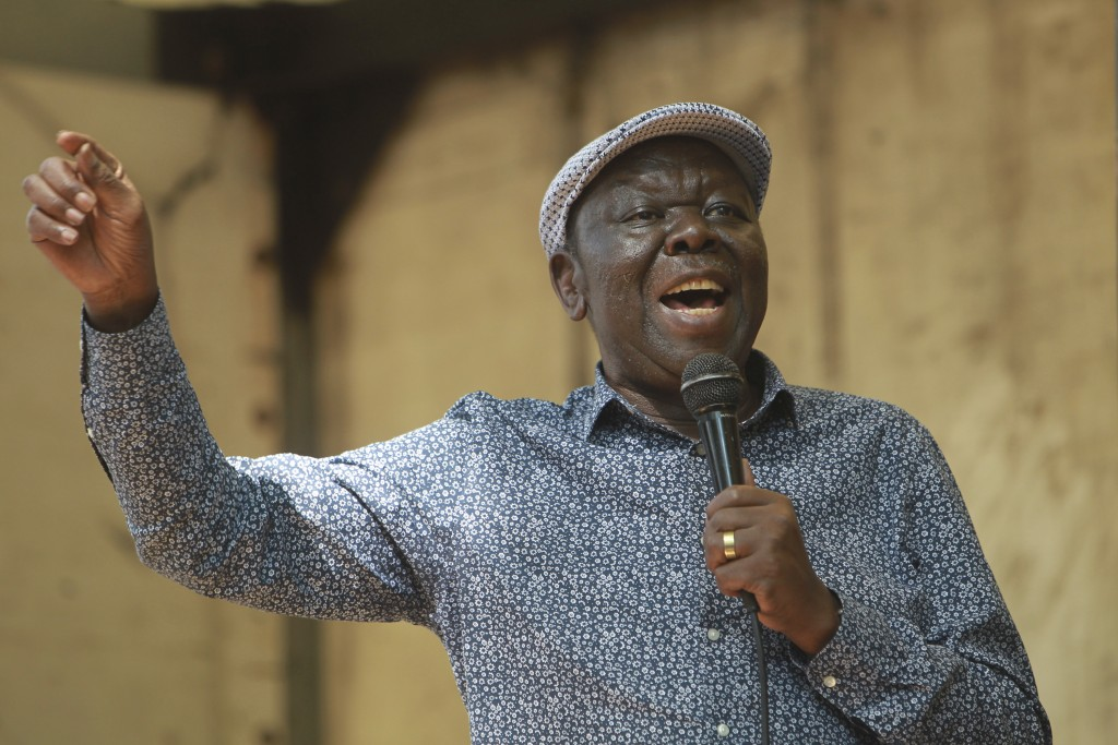 FILE - In this Tuesday, Nov, 21, 2017 file photo, Morgan Tsvangirai, the main opposition leader in Zimbabwe addresses protestors outside parliament bu