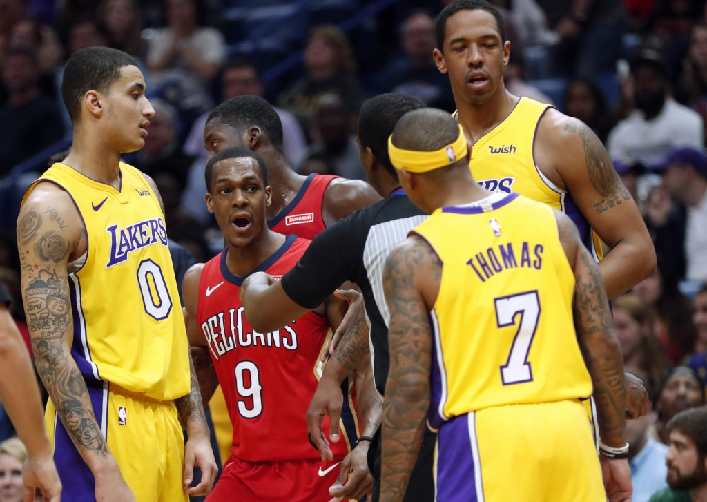 New Orleans Pelicans guard Rajon Rondo (9) and Los Angeles Lakers guard Isaiah Thomas (7) are separated by an official during the first half of an NBA