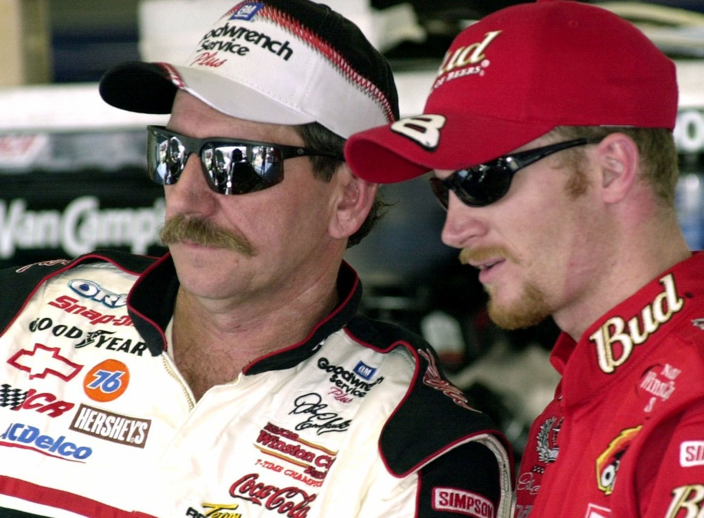 FILE - In this Friday, Feb. 9, 2001 file photo, NASCAR drivers Dale Earnhardt, left, and his son Dale Jr., stand together during a break in practice a