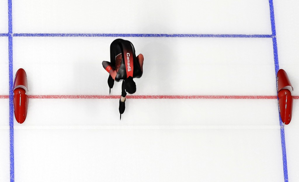 Canada's Ted-Jan Bloemen pushes his skate over the finish line to set a new Olympic record breaking the one that Jorrit Bergsma of The Netherlands set